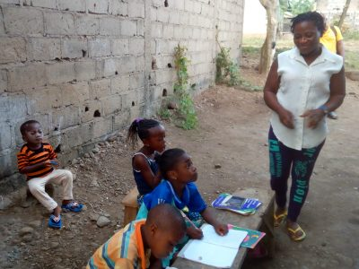 Students in a makeshift classroom in Cameroon