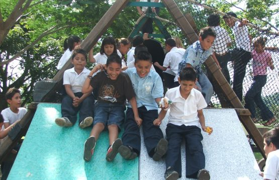 Kids sliding down a slide in Mexico