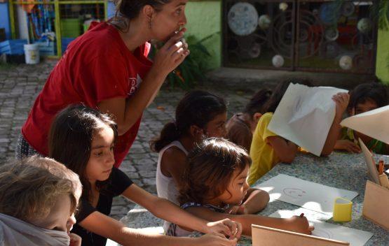 Nicole teaching arts and crafts