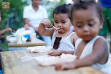 Toddlers eating spaghetti in the Philippines