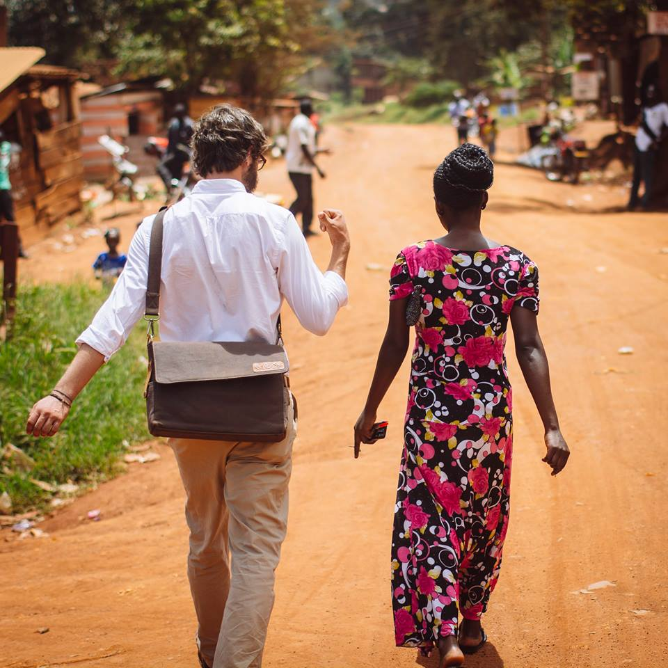 Drew with a local community member in Uganda