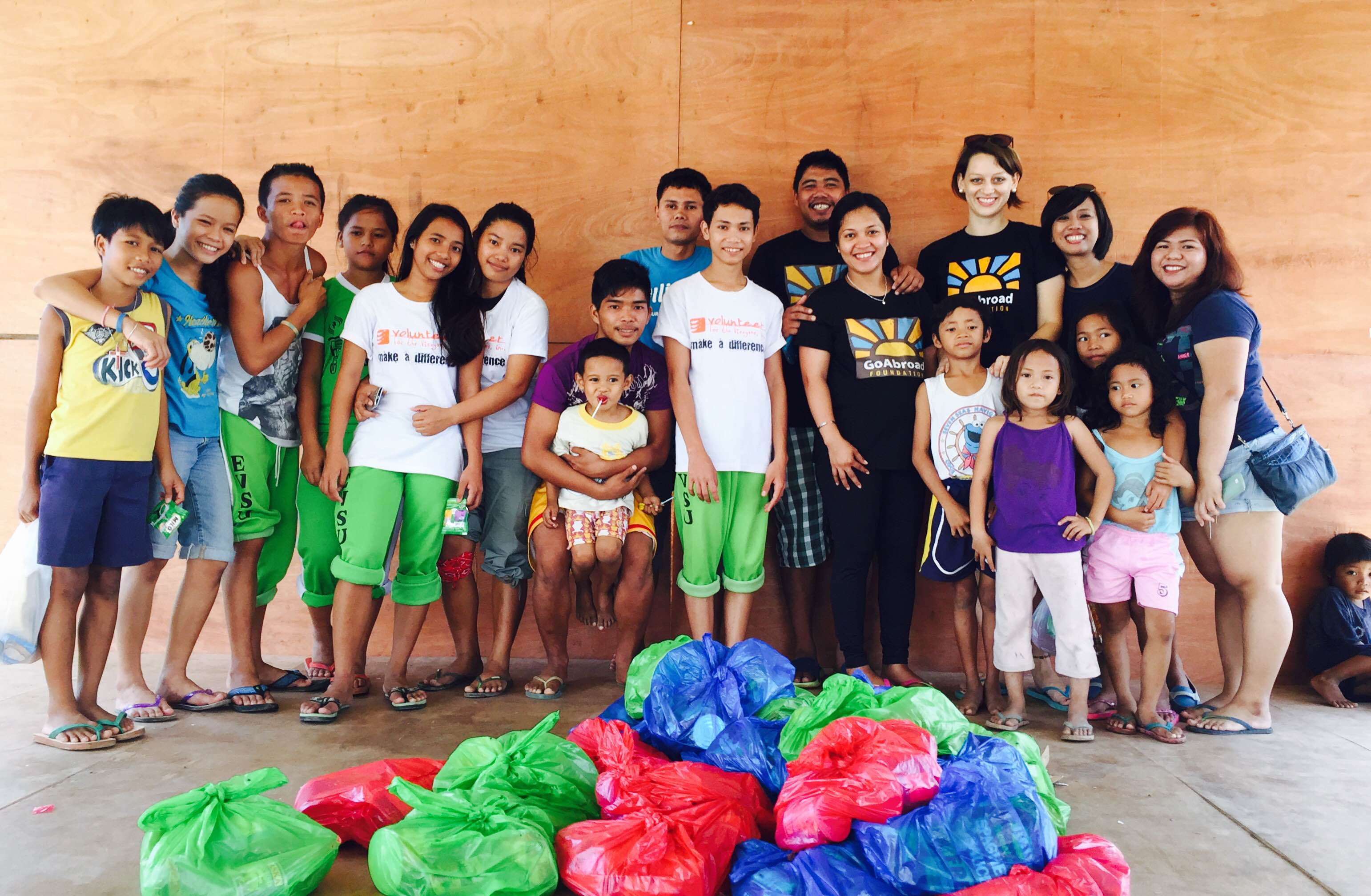 Volunteers and local children in the Philippines