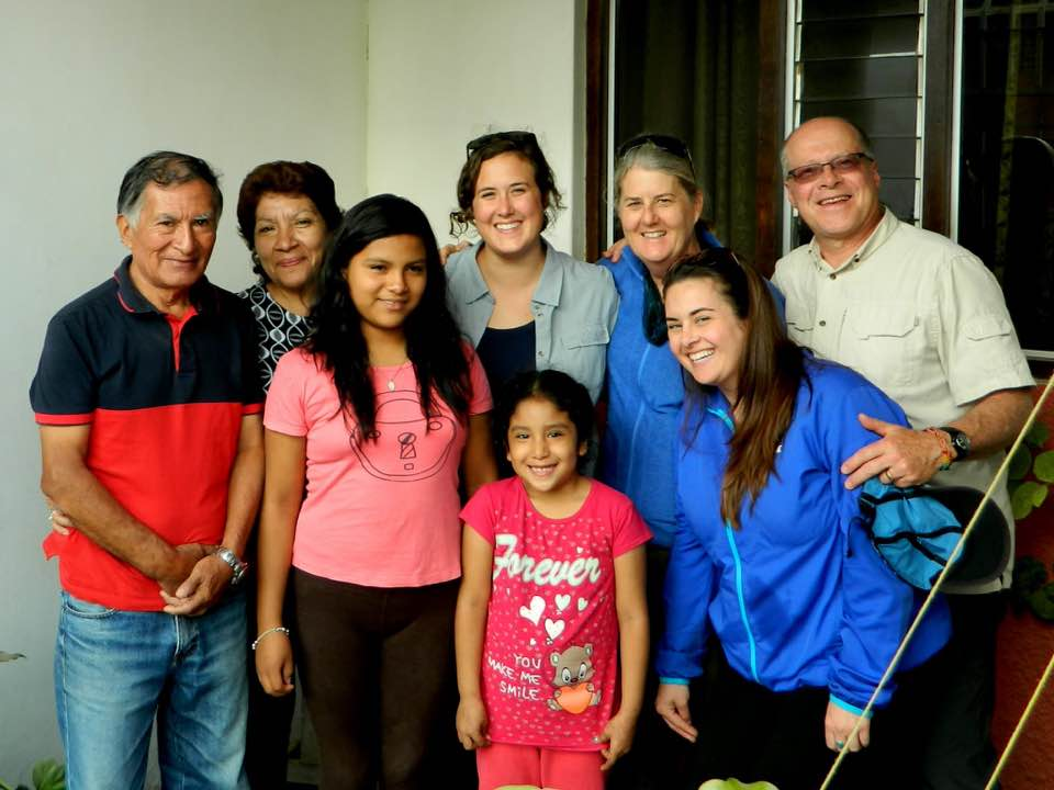 Volunteer with host family in Peru