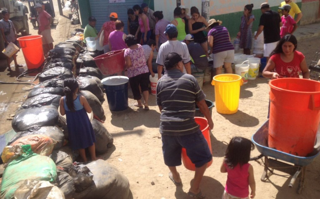 People preparing sand bags in peru