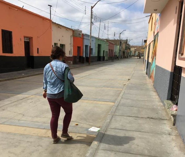 Volunteer walking down the street in Peru
