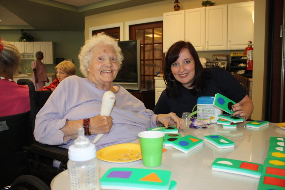 Volunteer with a patient at a nursing home