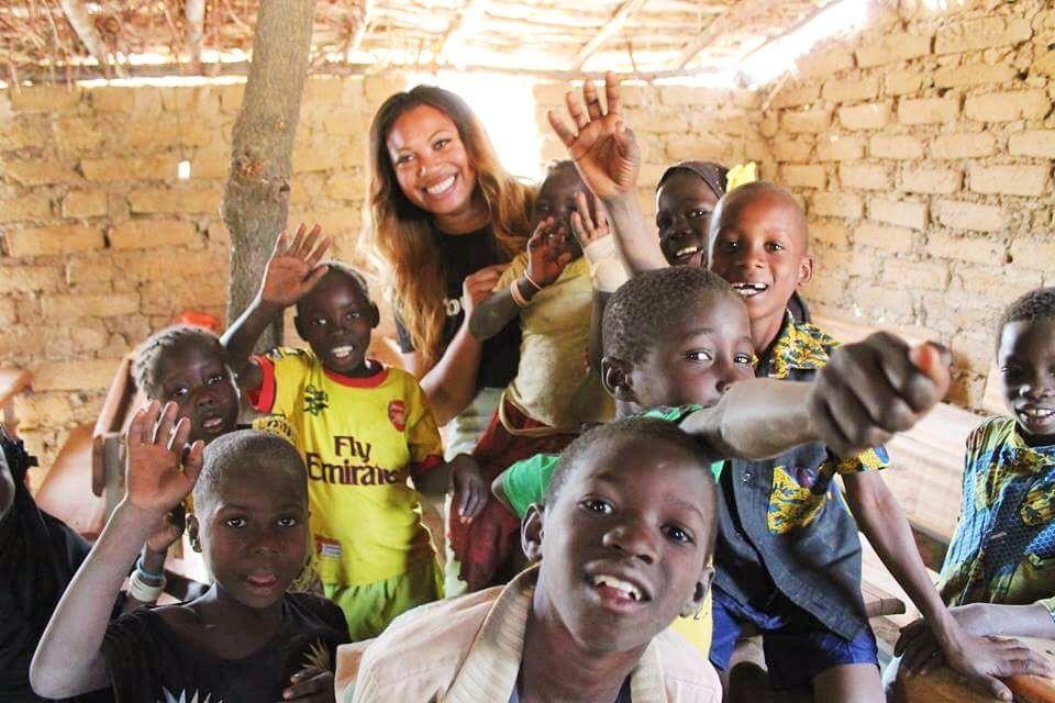 Volunteer with children in Burkina Faso