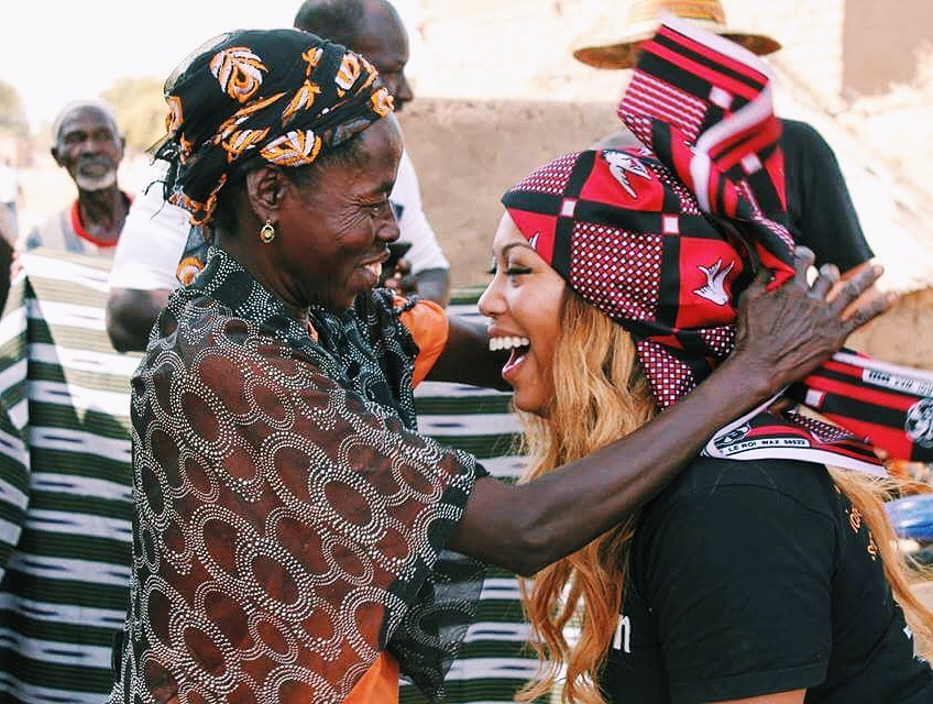Volunteer with a local woman in Burkina Faso