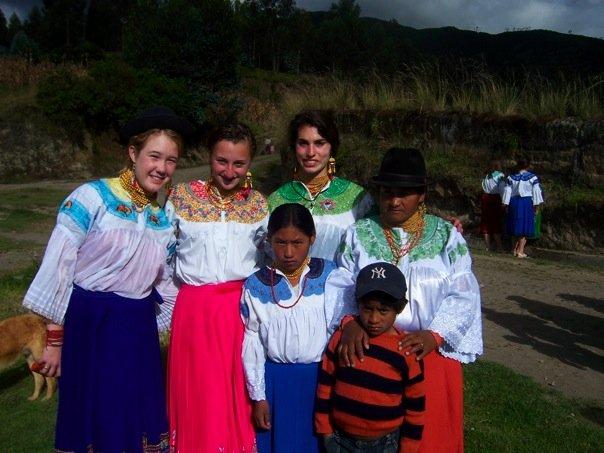 Volunteers with local children in Ecuador