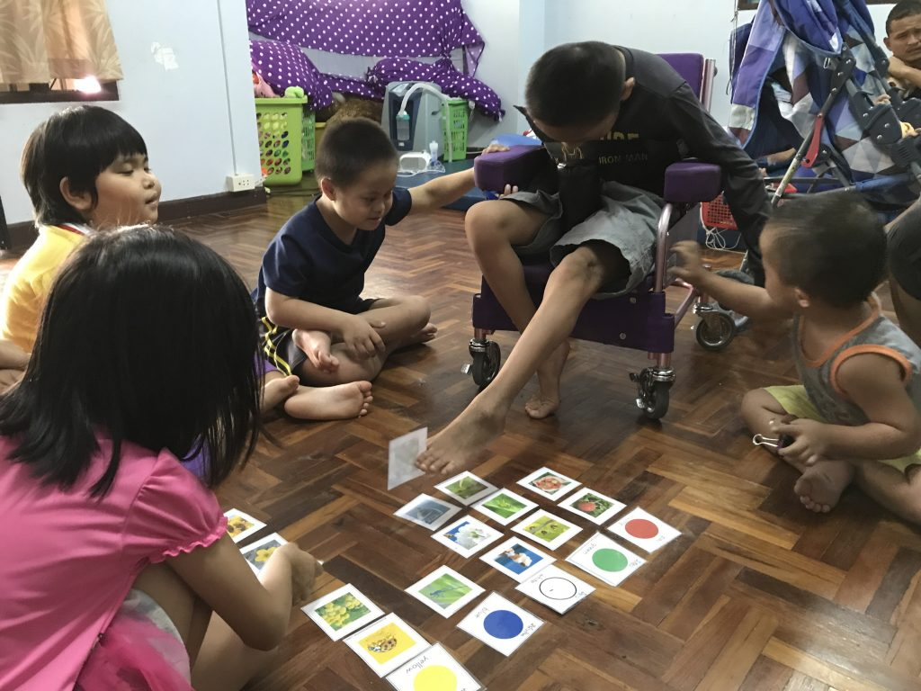 disabled kids playing a game in thailand