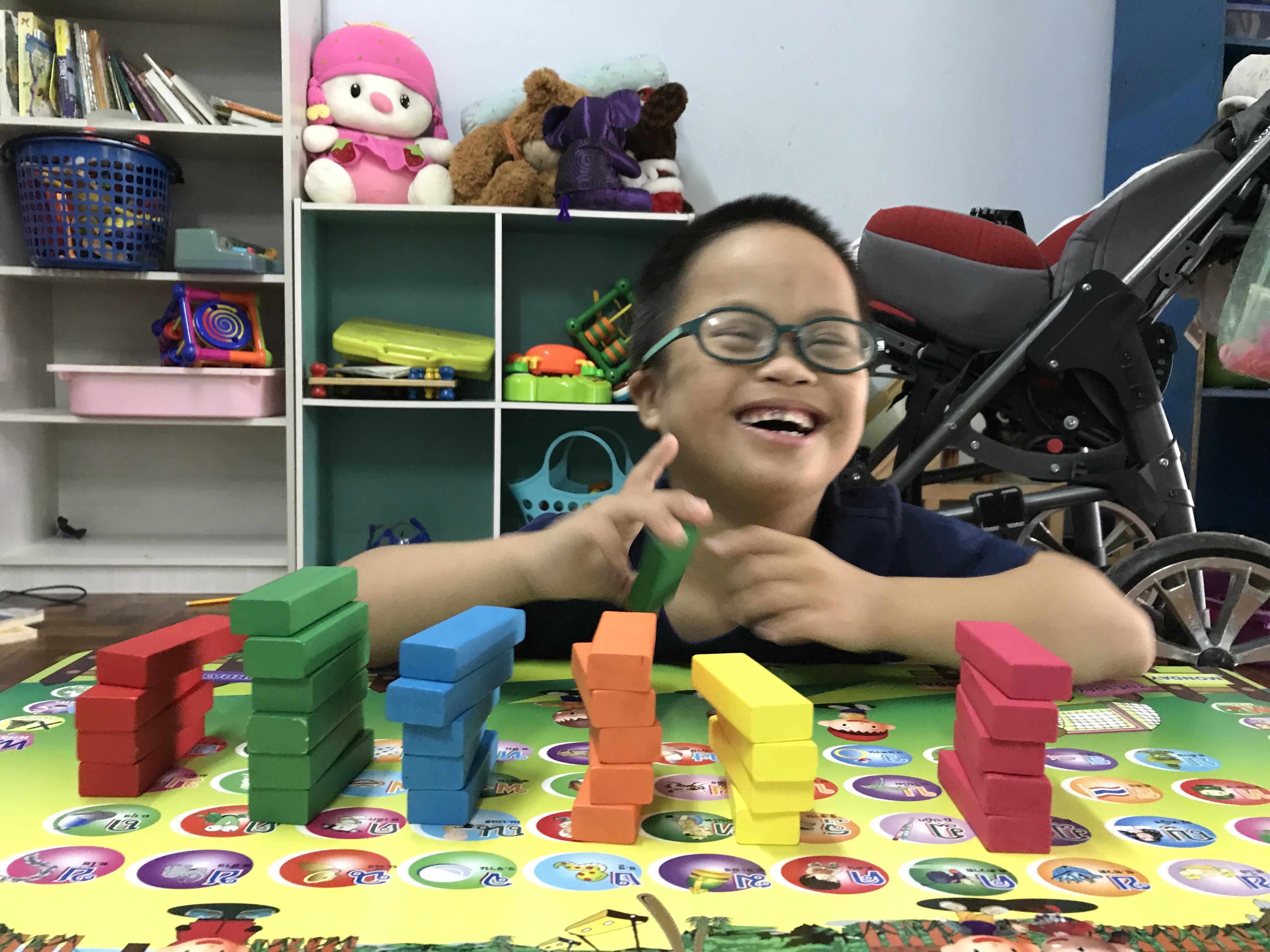 LeLe arranging colored blocks