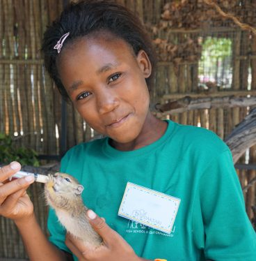 South African child with squirrel