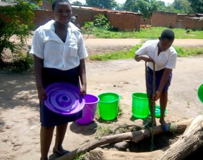 girls gathering water in Malawi