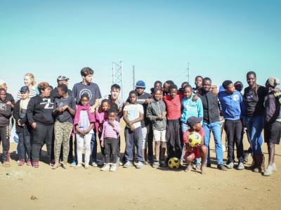 SAVWA volunteers with kids