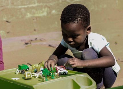 South African child playing with toys
