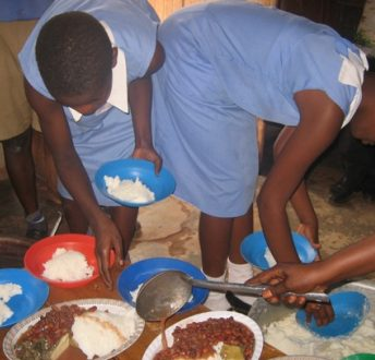 students helping to serve